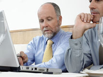 Businessmen Using Laptop In Restaurant Stock Photos