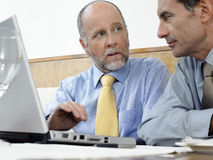 Businessmen Using Laptop In Restaurant Royalty Free Stock Photography
