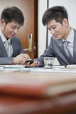 Businessmen Using Mobile Phone Stock Photo