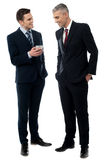 Businessmen using mobile phone Royalty Free Stock Photography