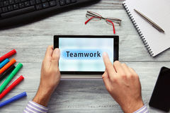 Businessmen using touchpad. Pressing Teamwork button. Stock Photography