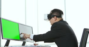 Businessmen viewing the contents of VR device.