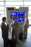 Businessmen waiting in airport Stock Photo