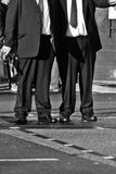 Businessmen waiting at the pedestrian crossing Royalty Free Stock Photography