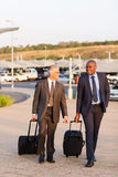 Businessmen walking airport Royalty Free Stock Photo