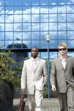 Businessmen Walking Blue Background Royalty Free Stock Photography