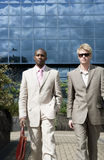Businessmen Walking Blue Background Stock Photography