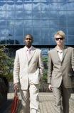 Businessmen Walking Blue Background Stock Photography