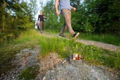 Businessmen Walking On Footpath By Lit Tealight Candle In Forest. During hike Royalty Free Stock Images