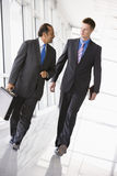 Businessmen walking through lobby Royalty Free Stock Photo
