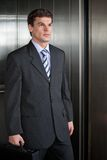 Businessmen Walking Out From Elevator Royalty Free Stock Images