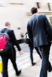 Businessmen walking on the street Royalty Free Stock Photos