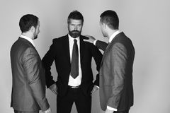 Businessmen wear smart suits and ties. Leaders try to find solution on light grey background. Argument and business conflict concept. Men with beard and Stock Image