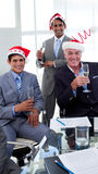 Businessmen wearing novelty Christmas hat Stock Image