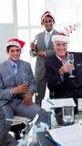 Businessmen wearing novelty Christmas hat Stock Image
