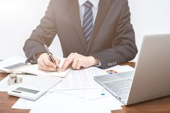 Businessmen who records in notebooks royalty free stock images