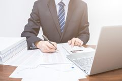 Businessmen who is using calculator stock photography
