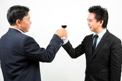 Businessmen wit wine Stock Images