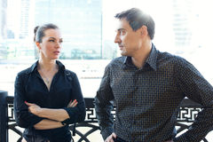 Businessmen and woman in the business center. Royalty Free Stock Photography