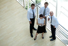 Businessmen and woman standing by railing, portrait Stock Photos