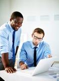 Businessmen at work Stock Photos