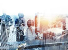 Businessmen that work together in office. Concept of teamwork and partnership. double exposure stock photo