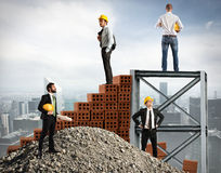 Businessmen work together to build a building Royalty Free Stock Photo