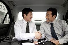 Businessmen working in back of car Stock Photos