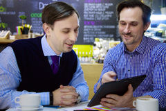 Businessmen are working in cafe Royalty Free Stock Photos