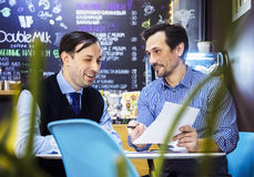 Businessmen are working in cafe Royalty Free Stock Image