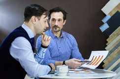 Businessmen working with graphs and discuss the income table stock photo