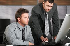 Businessmen working with computer Royalty Free Stock Photos