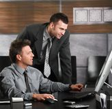 Businessmen working with computer Stock Images