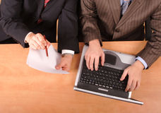 Businessmen working on document Royalty Free Stock Image