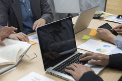 Businessmen working with document, digital tablet, laptop comput. Er for use as workplace concept Royalty Free Stock Images