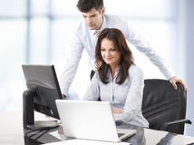 Businessmen working with his colleague Stock Photo