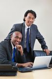 Businessmen working on laptop Stock Photos