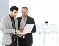 Businessmen working with laptop in meeting room Stock Photography