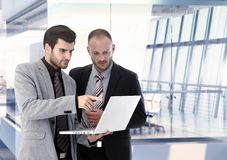 Businessmen working with laptop. At office, discussing. Copyspace Royalty Free Stock Images