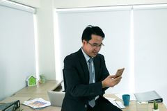 Businessmen are working on a mobile phone. Businessmen are working on a mobile phone Stock Image
