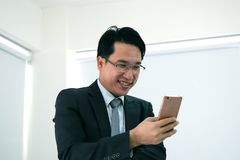 Businessmen are working on a mobile phone. Businessmen are working on a mobile phone at office Stock Photography