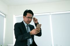 Businessmen are working on a mobile phone. Businessmen are working on a mobile phone at office Stock Photo