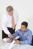 Businessmen Working In Office Stock Images
