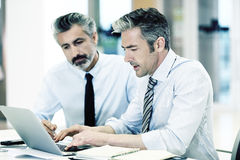 Businessmen working at office Stock Photo