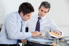 Businessmen Working In Office Stock Photo