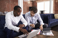 Businessmen Working On Sofas In Relaxation Area Of Office Royalty Free Stock Photo