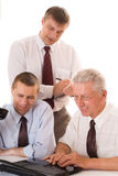 Businessmen working at a table Royalty Free Stock Photo