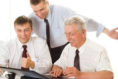 Businessmen working at a table Royalty Free Stock Image