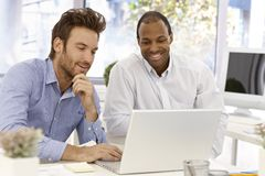 Businessmen working together Stock Images