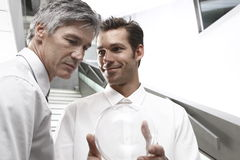 Businessmen working together. Two businessmen working together on a project Royalty Free Stock Images